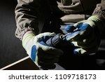 closeup photo of a worker in...   Shutterstock . vector #1109718173