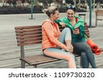 happy two girls are talking and ... | Shutterstock . vector #1109730320