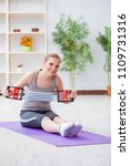 young woman exercising with... | Shutterstock . vector #1109731316