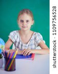 girl studying at the desk ... | Shutterstock . vector #1109756528