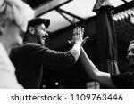 friends giving a high five | Shutterstock . vector #1109763446