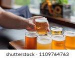man tasting beer from flight at ... | Shutterstock . vector #1109764763