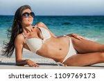 young woman in bikini laying by ...   Shutterstock . vector #1109769173