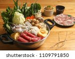hot pot on table background. | Shutterstock . vector #1109791850