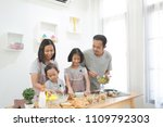 happy family asian cooks in the ... | Shutterstock . vector #1109792303