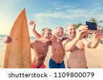 surfers at a nice beach | Shutterstock . vector #1109800079