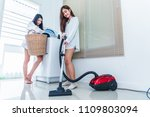 two asian women doing housework ... | Shutterstock . vector #1109803094