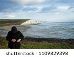 man standing at seven sisters... | Shutterstock . vector #1109829398