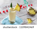 pina colada cocktail garnished... | Shutterstock . vector #1109842469
