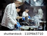 group of chefs working in the... | Shutterstock . vector #1109865710