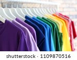 rack with rainbow clothes on... | Shutterstock . vector #1109870516