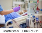 Small photo of The specialist are doing continuous renal replacement therapy equipment and injection pump.