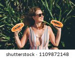 young woman with papaya during... | Shutterstock . vector #1109872148