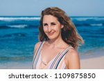 portrait of woman on the beach... | Shutterstock . vector #1109875850
