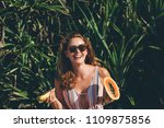young woman with papaya during... | Shutterstock . vector #1109875856