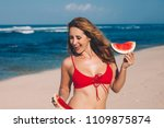 young woman in red bikini with... | Shutterstock . vector #1109875874