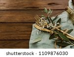 gold cutlery with linen napkin... | Shutterstock . vector #1109876030