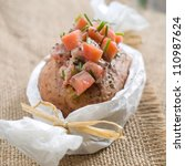 baked potato with salmon sauce, selective focus - stock photo