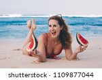 young woman in red bikini with... | Shutterstock . vector #1109877044