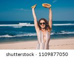 young woman with papaya on the... | Shutterstock . vector #1109877050