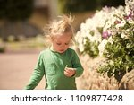 child is studying the flora and ... | Shutterstock . vector #1109877428