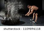 muscular man hitting wheel tire ... | Shutterstock . vector #1109896118