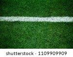 green grass soccer field close... | Shutterstock . vector #1109909909