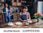 portrait of daughter spreading... | Shutterstock . vector #1109955350