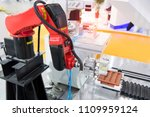 robotic arm machine tool at... | Shutterstock . vector #1109959124