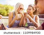 young women gossiping outdoor... | Shutterstock . vector #1109984930