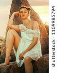 beauty summer outdoor portrait... | Shutterstock . vector #1109985794