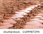 wheel trace on road  puddle and ... | Shutterstock . vector #1109987294