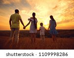 a happy family is standing in... | Shutterstock . vector #1109998286