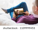 man watching movie on tablet at ... | Shutterstock . vector #1109999453