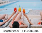 girls lying on chaise lounges... | Shutterstock . vector #1110003806