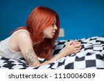 waking up in the morning. young ... | Shutterstock . vector #1110006089