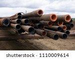 drilling pipe. rusty drill... | Shutterstock . vector #1110009614
