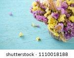 flowers on blue wooden table... | Shutterstock . vector #1110018188