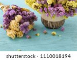 bouquet of flowers on blue... | Shutterstock . vector #1110018194