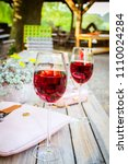 Small photo of A glass and a bottle of rose in the autumn vineyard. Harvest time, summer time in the garden on the terrace