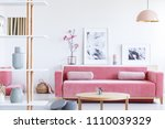 posters and flowers above pink... | Shutterstock . vector #1110039329