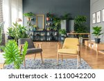 two chairs standing in a... | Shutterstock . vector #1110042200