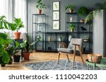 a chair on a patterned rug in a ... | Shutterstock . vector #1110042203