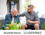 an adult hipster son and senior ... | Shutterstock . vector #1110054863