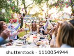 bride and groom with guests at... | Shutterstock . vector #1110054944