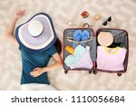 young woman packing suitcase... | Shutterstock . vector #1110056684