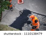 street resurfacing. fresh... | Shutterstock . vector #1110138479