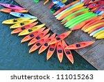 Colorful Kayaks Docked   As...
