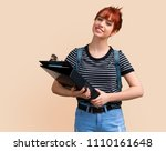 young student redhead girl with ... | Shutterstock . vector #1110161648