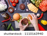 image on top of two hamburgers  ... | Shutterstock . vector #1110163940